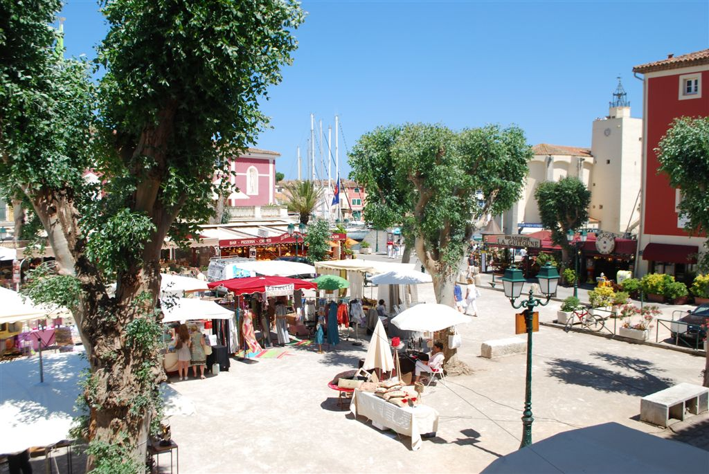 The Market Square in Port Grimaud. In the background, you can see the church where François Spoerry, the creator of Port Grimaud, is buried.